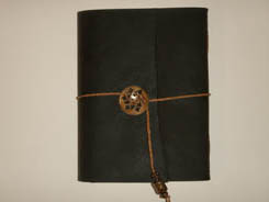 Leather wrapped journal closed and ties with thin leather string